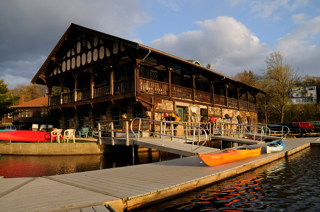 A photo of the Newton historic boathouse along the Charles River
