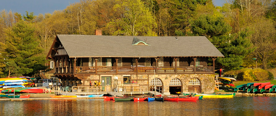 Photo of the historic boathouse in Newton where you can kayak from. by Paddle Boston Rentals